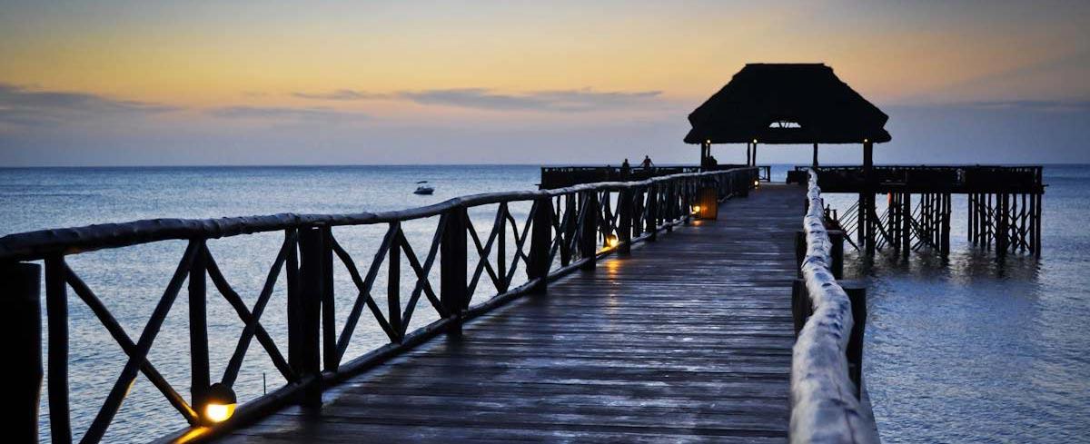 Wooden bridge to pier in Indian Ocean Zanzibar