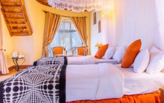 Twin beds at Farm of Dreams Lodge