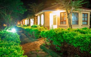 Flamingo Safari Lodge Karatu Cottages at Night